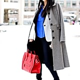 A furry hat and brilliant colors on her top and bag got this styler noticed.