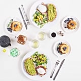 Here's a brunch table we would love to sit at: avocado toast, poached egg and bacon toast, blueberry pancakes, and a salad of arugula, grapes, and almonds. Source: Instagram user paulinefashionblog