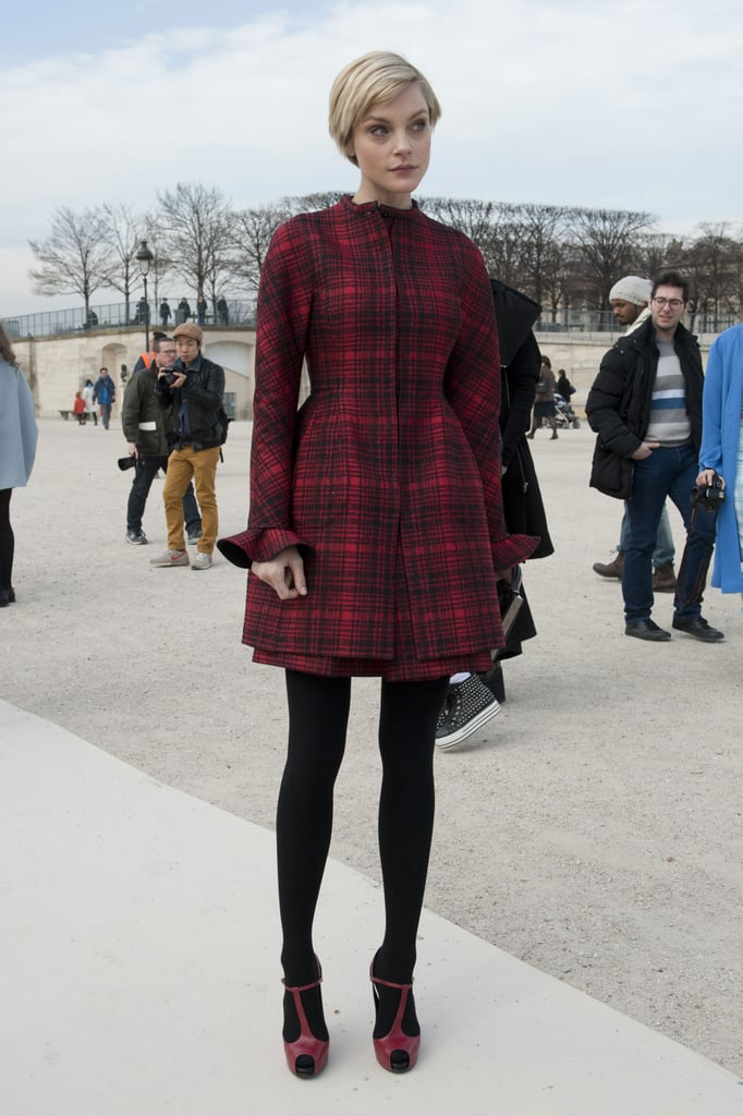Jessica Stam covered up in a rich red plaid and coordinated red T-strap heels.
