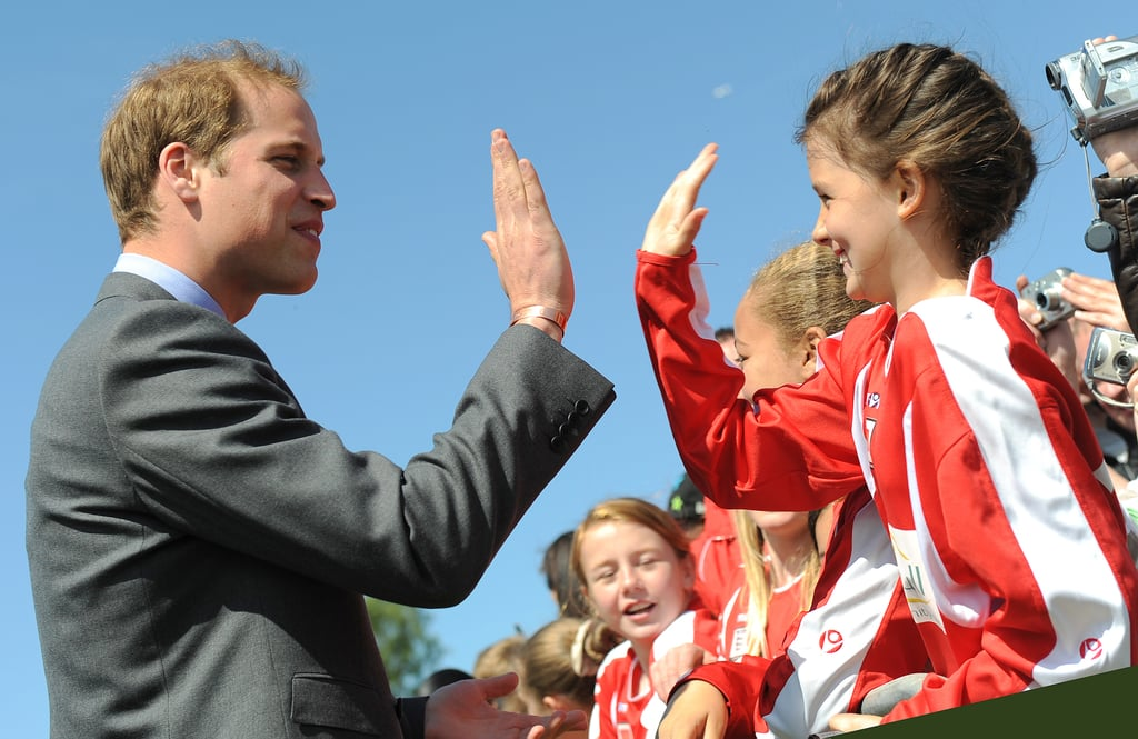 Prince William gave a young girl some skin during a royal visit at West Midlands in May 2009.