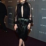 Ginnifer Goodwin channeled a sultrier style in a key-hole cutout Gucci dress complete with a dark, feathered skirt.