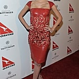 The model lit up the red carpet in a fiery Georges Chakra Couture embellished sheath and gold Christian Louboutin peep-toes at a Qantas airways party at the Roosevelt Hotel in Hollywood.