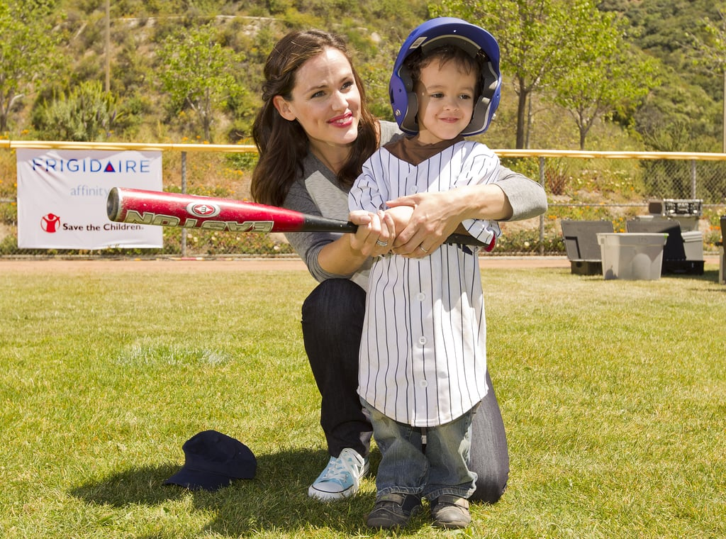 Jennifer Garner helped a young boy perfect his swing at a Save the Children charity event in Glendale, CA yesterday. She got into the game as part of her work as an ambassador for Frigidaire, which she's been involved in since 2009. Jennifer spent the day on the field after enjoying a weekend with her own little ones, Violet and Seraphina. She and Seraphina prepped for Easter on Saturday, and now the Garner-Affleck family has another important event to gear up for. Jennifer revealed their royal wedding plans, which include a special breakfast on Friday to commemorate William and Kate's big day.