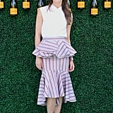 """Keri Russell's outfit at this year's Veuve Clicquot Polo Classic spoke to me right away. As soon as I laid eyes on her Johanna Ortiz frilled midi skirt, a light bulb went off. I want to be wearing one trendy piece like this with either a tucked-in tee or an elevated sleeveless blouse like Kerri's. Of course, I'll pack my wide-brimmed hat for whichever BBQ I attend but possibly swap the stilettos for a pair of espadrilles."" — Sarah Wasilak, editor, Fashion"