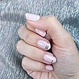 Using a double line on the tip of the nail creates a french manicure look without the harsh tip lines of a classic french mani