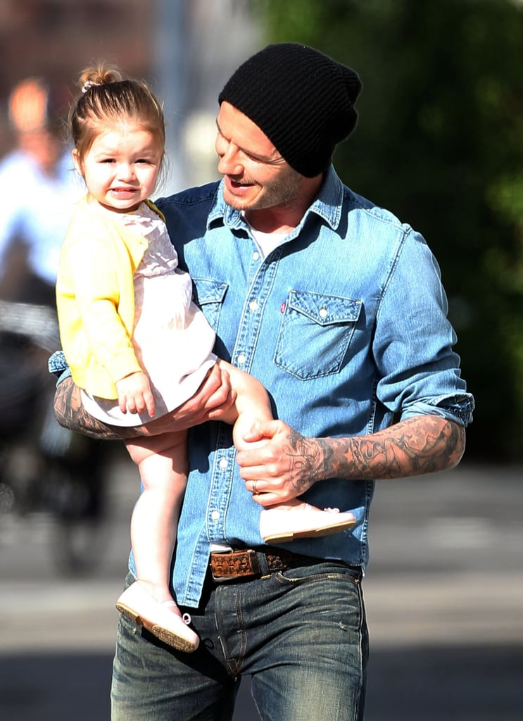 How cute is this? David couldn't help but grin at his adorable girl while he and Harper went for a walk around their London neighborhood in April.