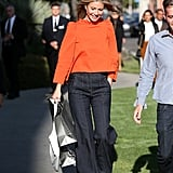 Gwyneth Paltrow Wearing an Orange Top and Jeans