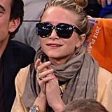 Mary-Kate Olsen contrasted a light top and scarf with her dark, structured shades at a New York Knicks game in 2013.
