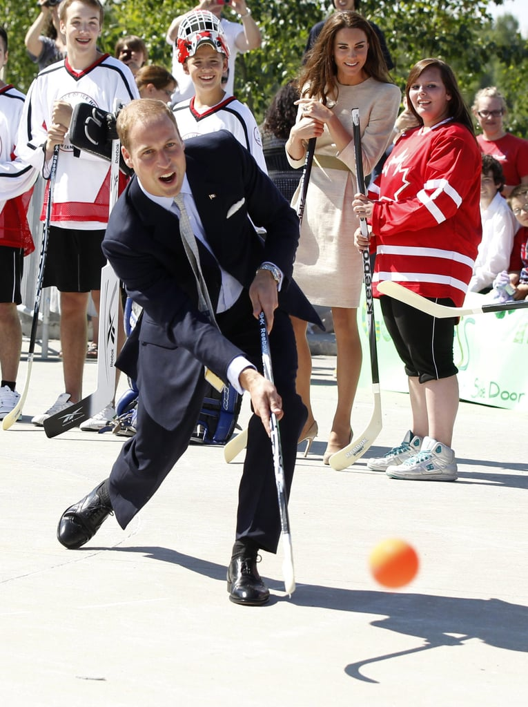 The royal took a shot with a hockey stick during his visit to the Somba K'e Civic Plaza in July 2011.