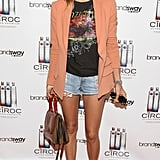 Jessica Hart goes old school with the footwear, but keeps her cutoffs fresh with a printed tee and a unexpected pop of peach on her blazer.