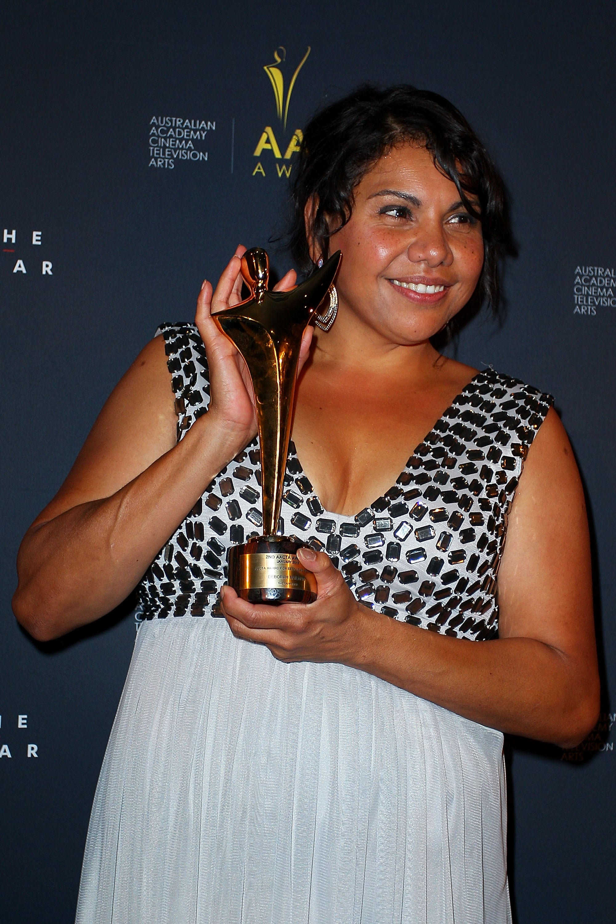 Deborah Mailman posed with her best actress AACTA Award.