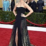Morena Baccarin's strapless Basil Soda gown showcased her toned arms with a dash of a sexy leg action. She completed her SAG Awards style with strappy black sandals and jade drop earrings by Jacob & Co.