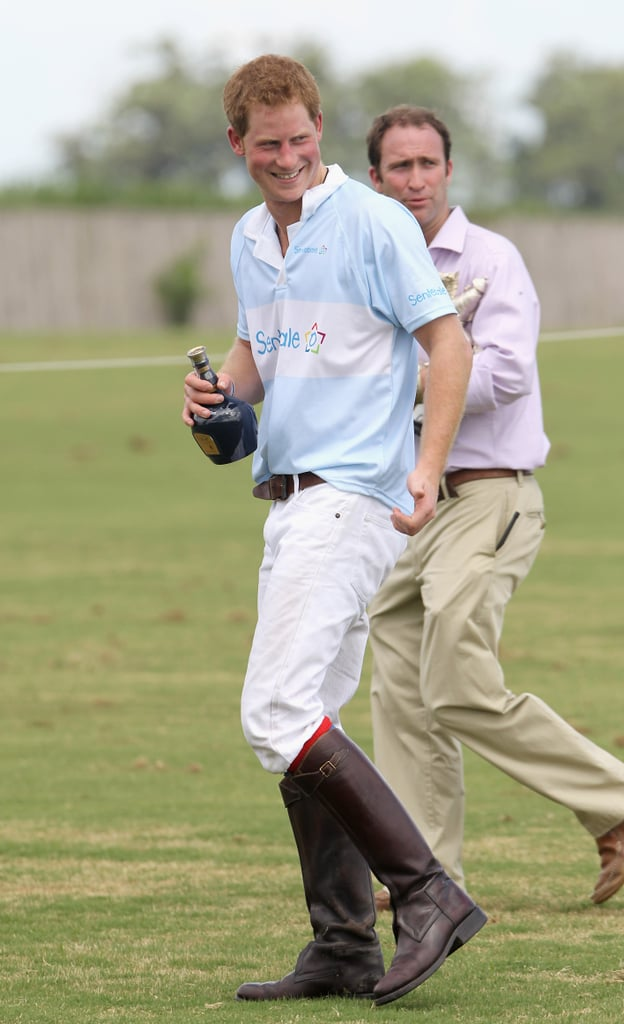 Prince Harry held a bottle of Royal Salute whisky after playing polo in Brazil.