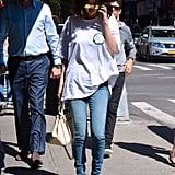 Selena styled her denim with an oversize band t-shirt featuring The Mighty Mighty Bosstones logo and Louis Vuitton patent ankle booties. She also carried the Selena Grace Coach bag from her collab with the brand.