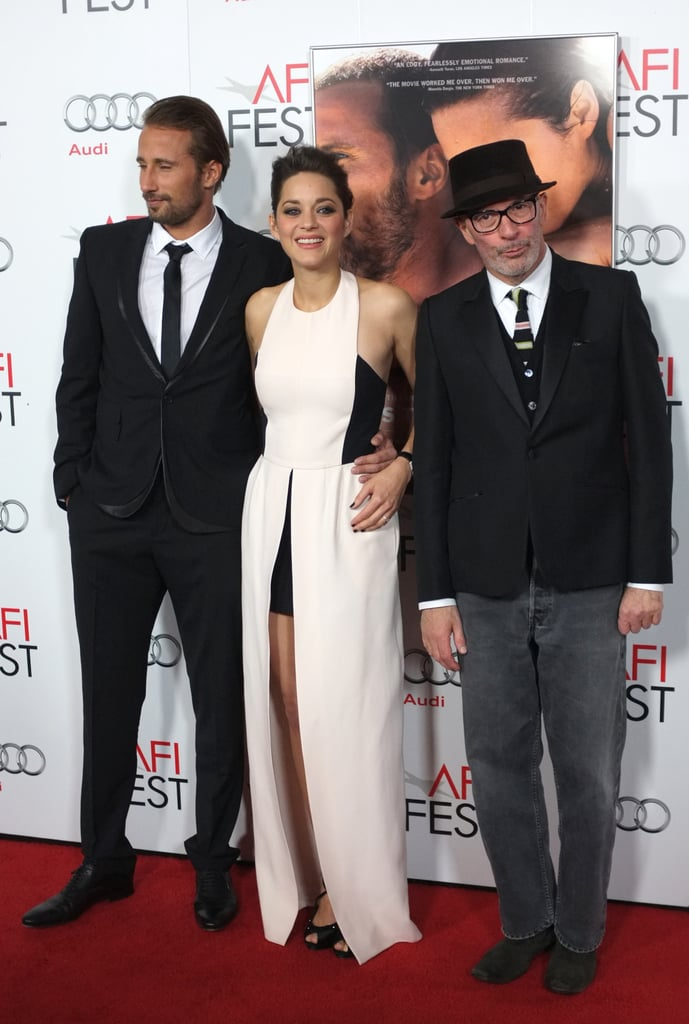 Marion Cotillard posted with writer/directory Jacques Audiard and her costar Matthias Schoenaerts.