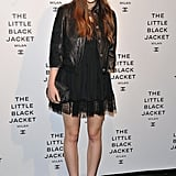 Elizabeth Olsen attended Chanel's Little Black Jacket dinner in Milan in a lace-detailed LBD and a textured black leather jacket (how very appropriate!). As for accessories, Olsen complemented the sexy black look with peep-toe pumps, a sequined clutch, and chain necklaces.