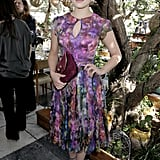 Dianna Agron's colorful Oday Shakar dress had plenty of pretty details: Peter Pan collar, dainty keyhole, and a pleated skirt. Her Jimmy Choo sandals and clutch were the perfect ending to her look.
