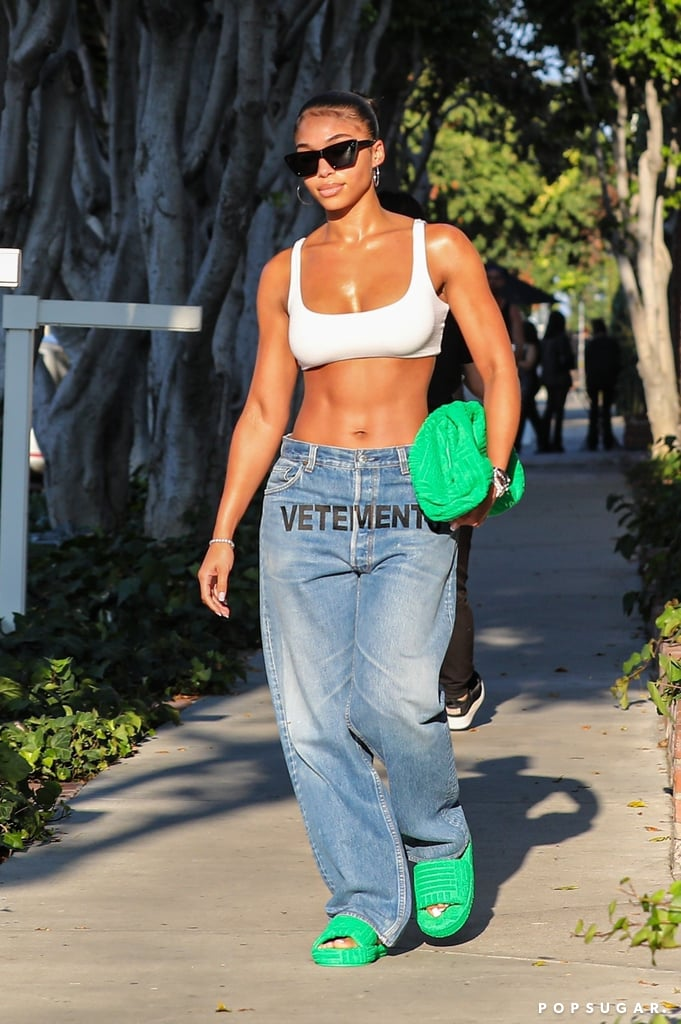 Help, we just can't seem to escape low-rise jeans! While I still refuse to accept that this trend I thought we left behind 20 years ago is all that flattering (at least on me), when it comes to Lori Harvey, there's an exception to the rule. Lori was recently spotted out and about in Beverly Hills looking like the chic, off-duty model she is, in a relaxed yet somehow very extra outfit.  Wearing a scoop-neck bra and baggy Vetements x Levi's jeans with the logo plastered across the front, Lori topped off her ensemble with a terrycloth Bottega Veneta clutch and matching slides. Plus, she added a pair of cat-eye sunglasses from Celine and silver jewelry for good measure.  If we had to guess, Lori's casual designer outfit totals an estimated $5,000 — the purse itself is almost two grand — so we'll just be admiring the look from our screens. Between the bright-green accessories, her shiny, sculpted abs, and the low-rise denim, it's hard to look away from this sexy outfit. See photos of Lori's latest fashion moment from all angles ahead.      Related:                                                                                                           If Cinderella Wore Bottega Veneta, Lori Harvey's Heels Would Be Her Glass Slippers