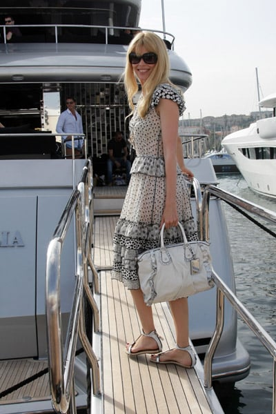 May 22: Claudia Schiffer arrives on Stefano Gabbana's yacht, Regina D'Italia