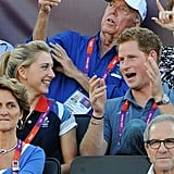 Prince Harry and Laura Trott watched the beach volleyball match on day 12 of the Olympics.
