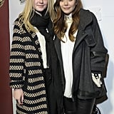 Dakota Fanning and Elizabeth Olsen bundled up in wool coats on the red carpet before heading into the Very Good Girls lunch at Sundance on Wednesday.