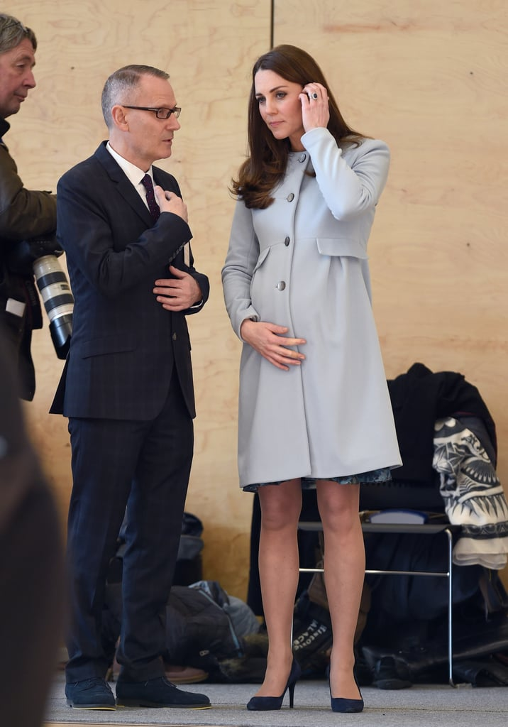 The Duchess of Cambridge made an official morning appearance in London on Monday to formally open the Kensington Leisure Center at the Kensington Aldridge Academy. It was her latest in a recent string of public outings; last week she opened the Clore Art Room at the Barlby Primary School and showed up at the Fostering Network to speak with foster caregivers. All eyes have been on her growing baby bump, and on Monday she covered her pregnant belly in a blue cashmere Seraphine coatdress. Kate later changed into a floral dress that showed off her bump even more. While speaking with children at the center, Kate revealed that she can feel the baby kicking!