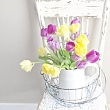These pastel tulips contrast nicely with the white pitcher, which is a homey substitute for a traditional vase.  Source: Instagram user conveythemoment