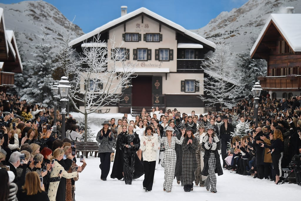 "The Grand Palais in Paris was transformed into a snowy Winter wonderland for the Chanel Fall/Winter 2019 show, which was also the final time we'd see the work of Karl Lagerfeld hit the runway. The legendary designer, who passed away in February, was honoured with a minute's silence, and guests were gifted an illustration of the designer standing next to Coco Chanel, accompanied by the words ""the beat goes on.""      Related:                                                                                                           The Hadid Sisters Closed the Show at Fendi, Setting the Scene For a Fitting Tribute to Karl Lagerfeld               Karl's Chanel swansong was designed with Virginie Viard, who is his successor at the label. Staged in a mock Swiss village, surrounded by snow, Chanel-branded skis, and all manner of wintry details, it featured all the hallmarks you'd expect of a classic Chanel show. There were monochrome tweed suits with wide-leg pants, cosy ski jackets with embellishment, marabou-trimmed cocktail dresses, dramatic capes, and Winter knits with beaded motifs. Penelope Cruz, in a fluffy skirt and ruffled top, carried a white rose down the runway, while Cara Delevingne led a poignant finale, giving peace signs to the cameras. Keep reading for a look at some of the best moments."