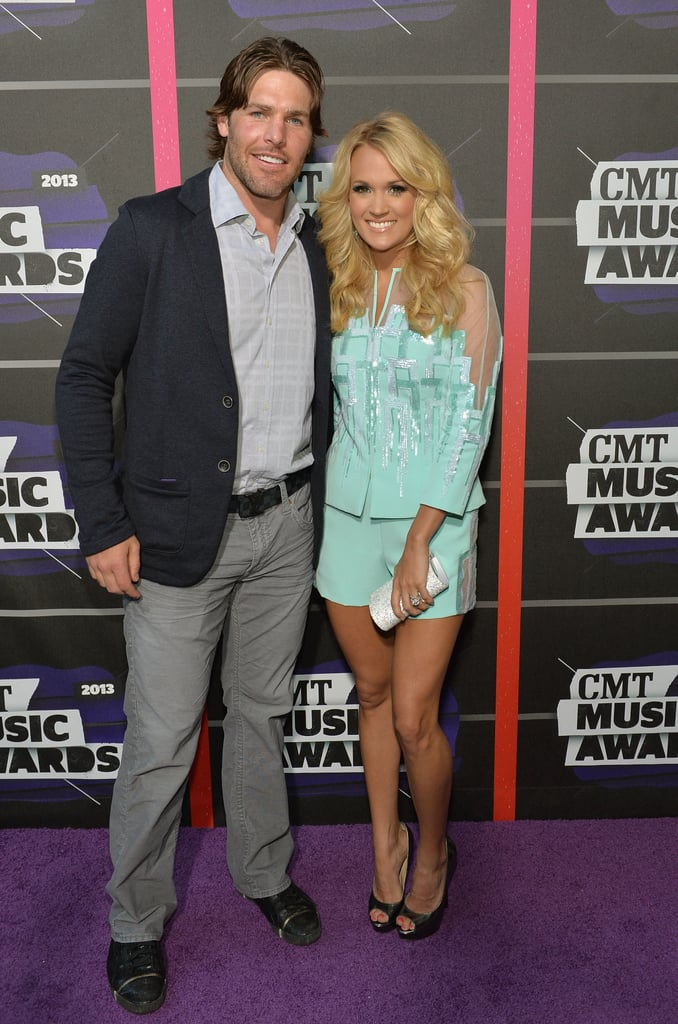 Carrie Underwood and Mike Fisher posed together at the CMT Awards.