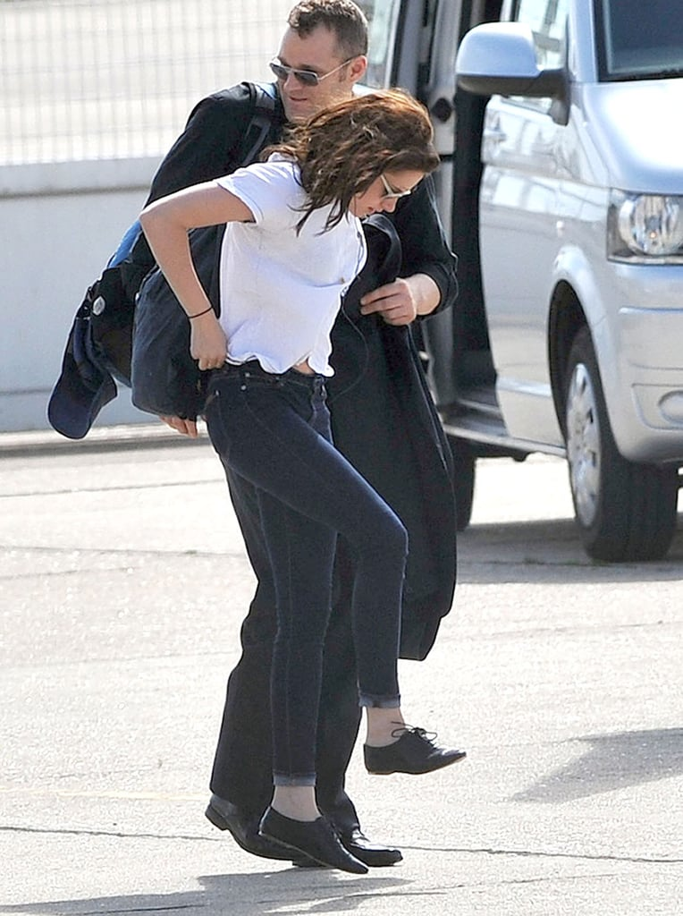 Kristen Stewart adjusted her pants.