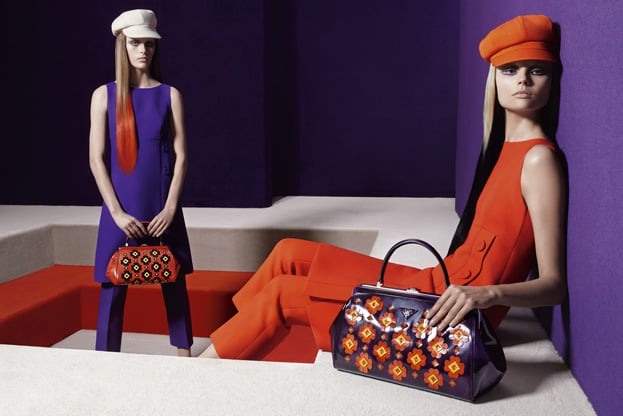 Newsboy caps, boldly printed bags, and even bolder sheaths are staples of Prada's Fall lineup.