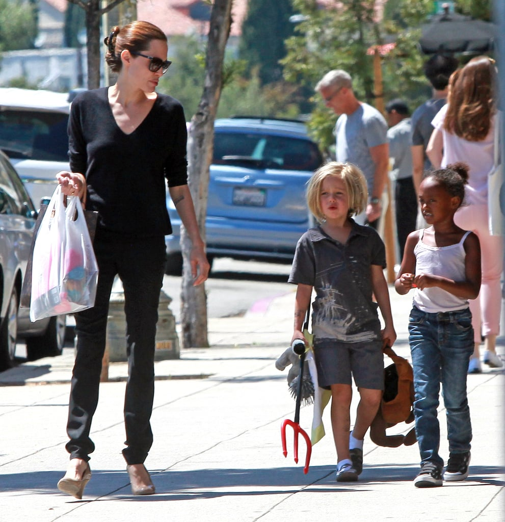 Shiloh Jolie-Pitt and Zahara Jolie-Pitt shop LA with Angelina Jolie.