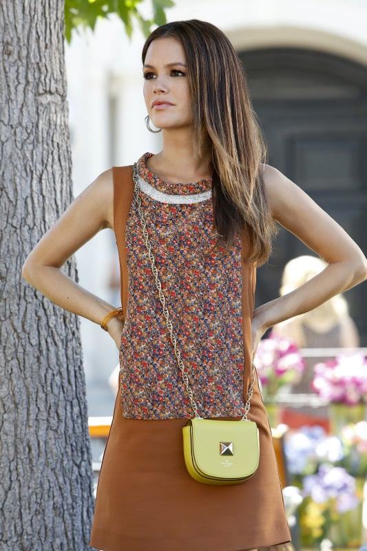 Zoe styled a printed Vanessa Bruno sheath dress with a mini yellow Kate Spade crossbody bag and Pura Vida bracelets in this week's episode. Shop this colorblock New York & Co. sheath dress ($60) and sunny Rebecca Minkoff crossbody ($325) to mimic Zoe's Fall-friendly style.