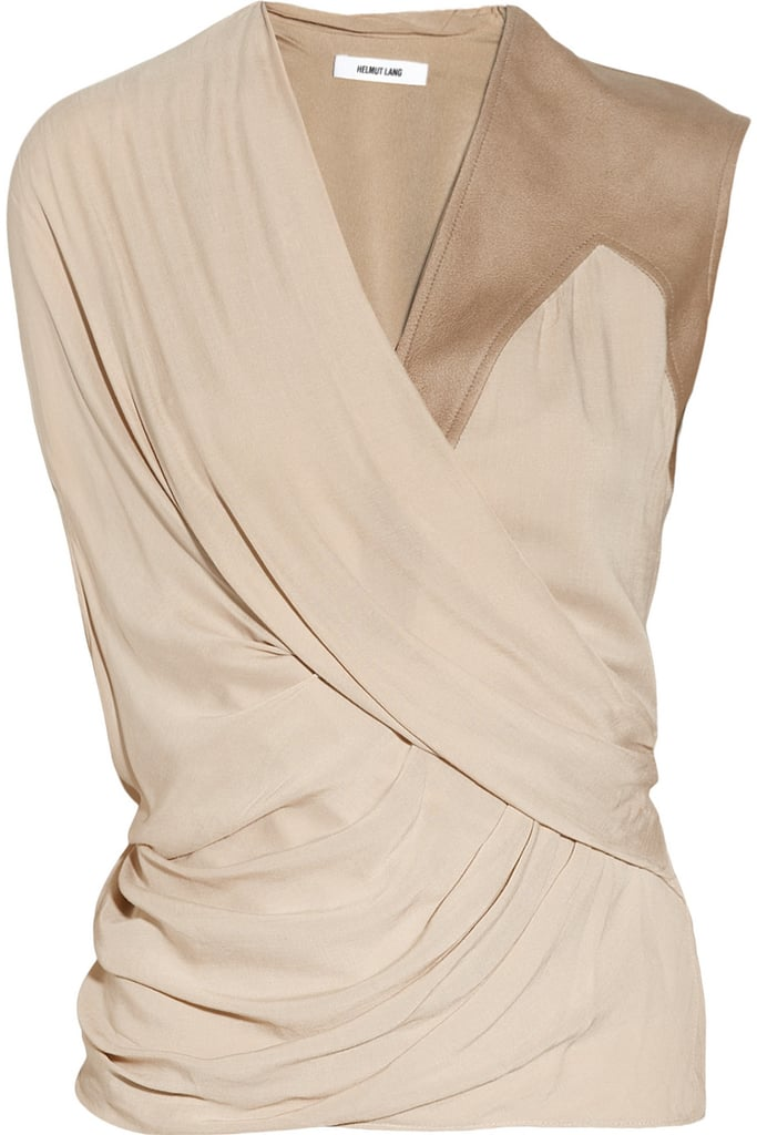This beautifully draped Helmut Lang Leather-Trimmed Draped Voile Top ($360) receives a slight edge from its leather shoulder. Contrast the soft, feminine folds with a pair of sleek pants for the evening.