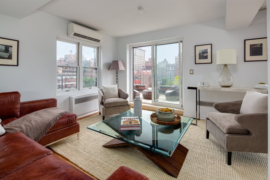 The apartment's many windows and sliding glass doors allow a great deal of light to enter.