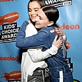 Hugging Hailee Steinfeld at the 2018 Kids' Choice Awards