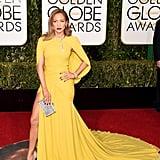 Jennifer Lopez wearing a Giambattista Valli gown, Jimmy Choo heels, and Harry Winston jewels in 2016.