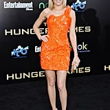 Elizabeth Banks turned heads in a bright orange Atelier Versace mini at the March premiere of The Hunger Games.