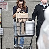 Eva Mendes got some help with rolling her cart out to her car.
