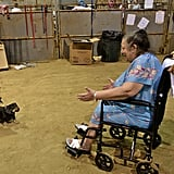 A woman is happy to see her rescued dogs at their temporary shelter in Gonzales, LA.