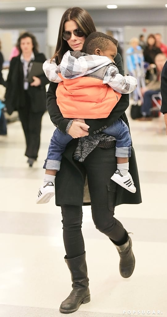 Sandra Bullock carried Louis through the airport.