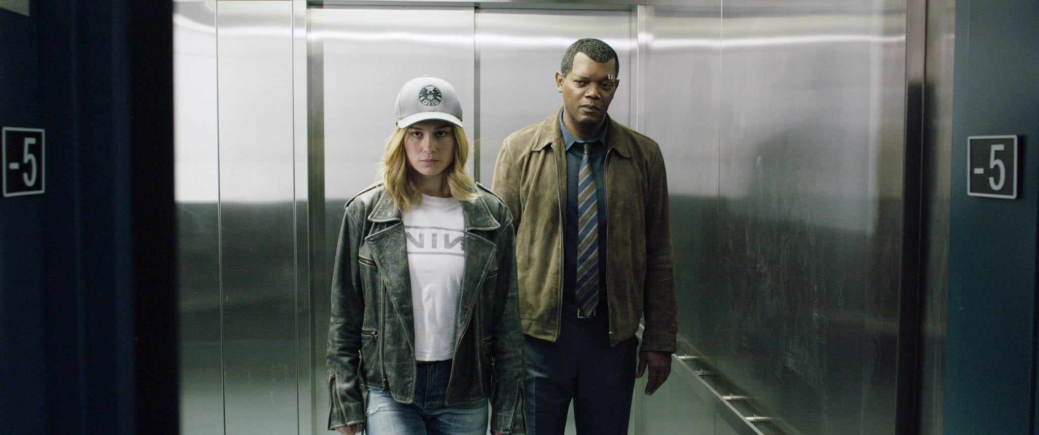 CAPTAIN MARVEL, from left: Brie Larson as Carol Danvers / Captain Marvel, Samuel L. Jackson as Nick Fury, 2019.  Walt Disney Studios Motion Pictures /  Marvel / courtesy Everett Collection