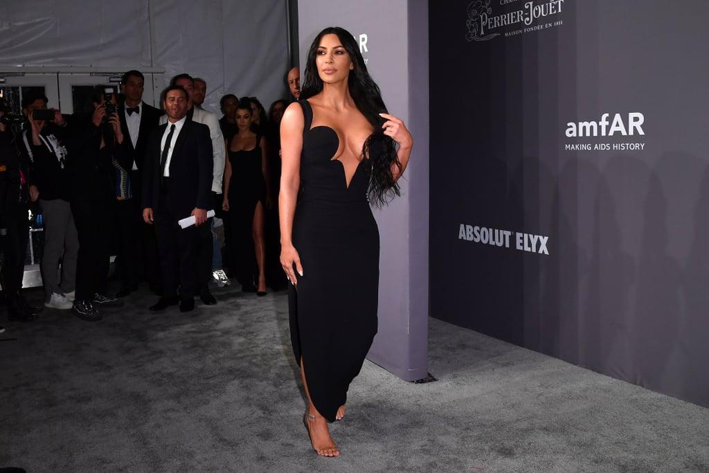 bece1a5103c Kim and Kourtney Kardashian Black Dresses amfAR Gala 2019