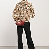 Leopard Goat Hair Bomber, Crepe Black Elastic Bottom Pant, Follow Me Black Patent Mid-Calf Boot, Sunset Watersnake Red Cross Body Bag. Photo courtesy of Tamara Mellon