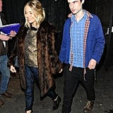 Sienna Miller held hands with Tom Sturridge to attend the No Quarter press night in London.
