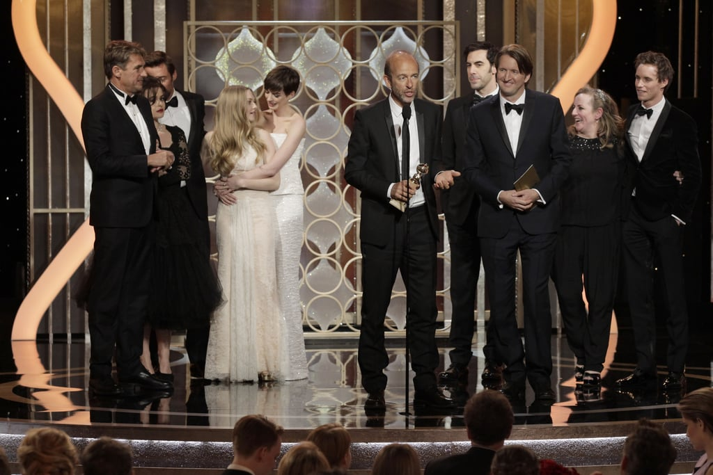 The cast hugged and celebrated on stage while accepting their best picture award at the Golden Globes.