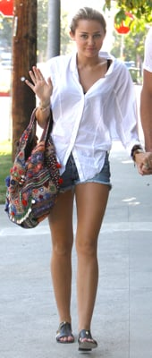 Miley Cyrus Wears Opening Ceremony Sandals and Simone Camille Bag in LA