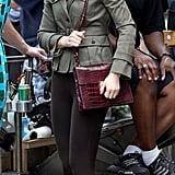 Leighton Meester stepped onto set in a decidedly equestrian-style ensemble — was it the cloche hat or the leather riding boots that gave it stable flair?