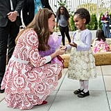 Kate looked completely smitten by this little girl during a visit to the Immigrant Services Society in Vancouver, Canada in September 2016.