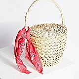 Free People's straw basket ($89) was made for toting — whether or not you're actually headed to a picnic.